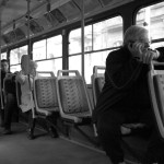 Man on Phone on Tram by Larry E. Fink